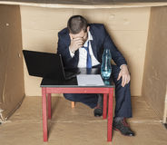 Businessman broke and drunk Royalty Free Stock Photos