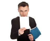 Businessman with broken hand with blank card Stock Photo
