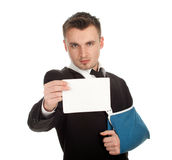 Businessman with broken hand keeping blank card Stock Photos