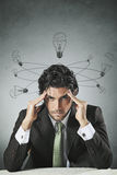Businessman with broken lamp bulbs Royalty Free Stock Photography