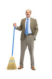Businessman with a broom Stock Photography