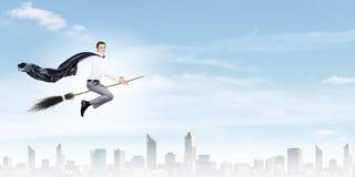 Businessman on broom Stock Image