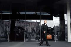 Businessman with a bag near the office  royalty free stock photography