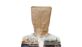 Businessman with brown paper bag on head, with double exposure of city at suit, isolated on white background Stock Photo