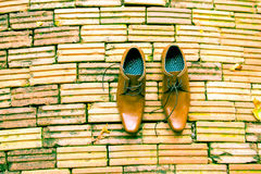 Businessman Brown Shoes Top View on brick background. Businessman Brown Shoes Top View Royalty Free Stock Image