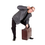 Businessman with brown suitcase Royalty Free Stock Image