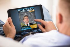 Businessman Looking At Business Magazine Royalty Free Stock Photography