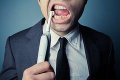 Businessman brushing his teeth Royalty Free Stock Photos