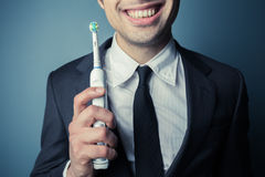 Businessman brushing his teeth Royalty Free Stock Images