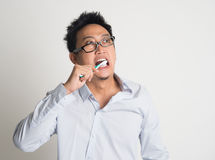 Businessman brushing teeth Stock Photos