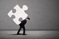 Businessman build puzzle Stock Photography