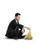 Businessman building coin city Royalty Free Stock Photo