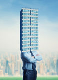 Businessman with building head Royalty Free Stock Photos