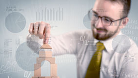 Businessman building a tower Stock Photos