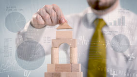 Businessman building a tower Royalty Free Stock Photos