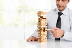 Businessman Building Up Tower, Business Concept Stock Image