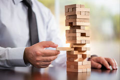Businessman Building Up Tower, Business Concept Stock Photos