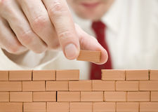 Businessman building a wall Stock Photos