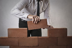 Businessman building a wall royalty free stock images