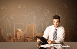 Businessman with buildings and measurements Stock Photo