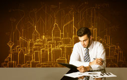 Businessman with buildings and numbers Royalty Free Stock Photo