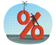 Businessman builds big red percent sign Stock Photography