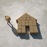 Businessman builds a house Stock Photography
