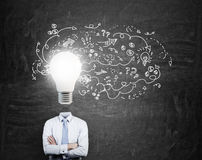 Businessman with bulb head Stock Images