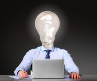 Businessman with bulb instead of his head Stock Photo