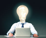 Businessman with bulb instead of his head Royalty Free Stock Photo