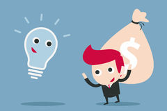 Businessman and bulb idea Stock Photos