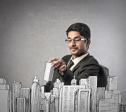 Businessman buliding a city Stock Photo