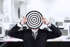 Businessman with bull's eye head at office Stock Image