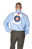 Businessman with bulls eye taped on his shirt Royalty Free Stock Photo