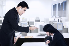 Businessman is bullying his subordinate. A businessman is bullying his subordinate in the office Stock Photos