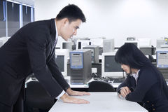 Businessman bullying his subordinate. Businessman is yelling at his employee in the office Royalty Free Stock Photos