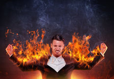 Businessman burning with anger Royalty Free Stock Photography