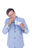 businessman burning a dollar banknote Stock Photo
