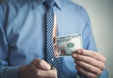 Businessman burning hundred dollar. Stock Photography