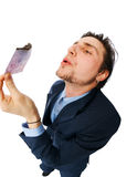 Businessman burning money Royalty Free Stock Photos