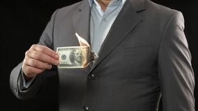 Businessman burning one hundred dollar bill, financial crisis bankruptcy concept. Stock photo royalty free stock photography