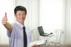 Businessman in business attire Stock Images