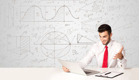 Businessman with business calculations background Stock Image