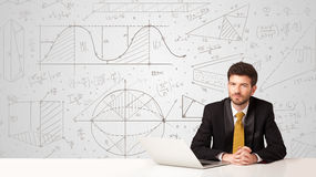 Businessman with business calculations background Stock Photo