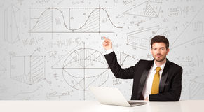 Businessman with business calculations background Royalty Free Stock Photo
