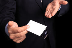 Businessman with a business card Stock Photos