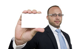 Businessman with a business card Royalty Free Stock Photo