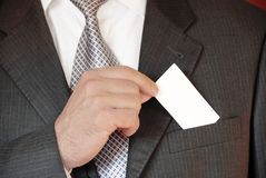 Businessman with business card Royalty Free Stock Photos