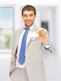 Businessman with business card Royalty Free Stock Images