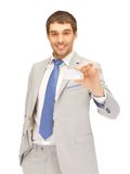 Businessman with business card Stock Photo